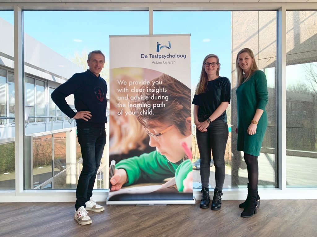 Three members of our team with our message 'The Test Psychologist provides you with clear insights during the learning path of your child'.
